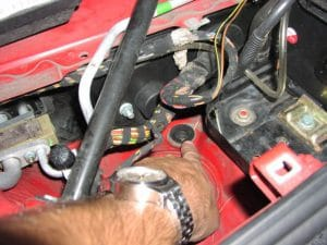 pointing to drain hole under the hood